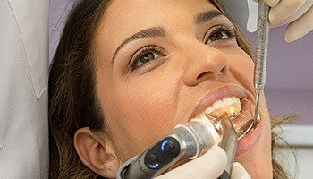 A female patient undergoing dental work while the dentist uses the Isolite System