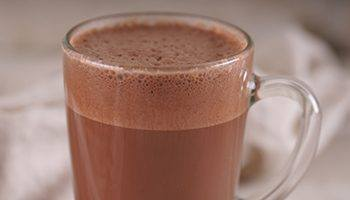 A glass filled with hot chocolate