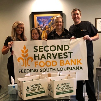 Team members holding food bank sign