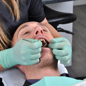 Male patient receiving dental care