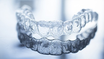Invisalign braces lying on highly reflective table
