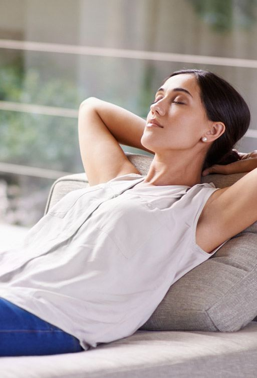 Completely relaxed woman lying on couch