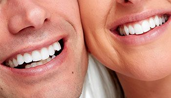 close-up of couple's white smiles
