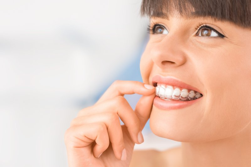 young attractive woman wearing invisalign