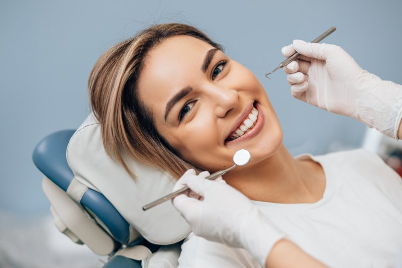 Closeup of woman smiling during dentist's appointment