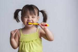 Little girl toothbrushing during National Children's Dental Health Month